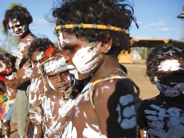 Our future generation participating in the indigenous hip hop videos in traditional paint